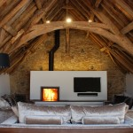 Medieval Tithe Grade II* Listed Barn Conversion by The Bazeley Partnership Architects in Cornwall